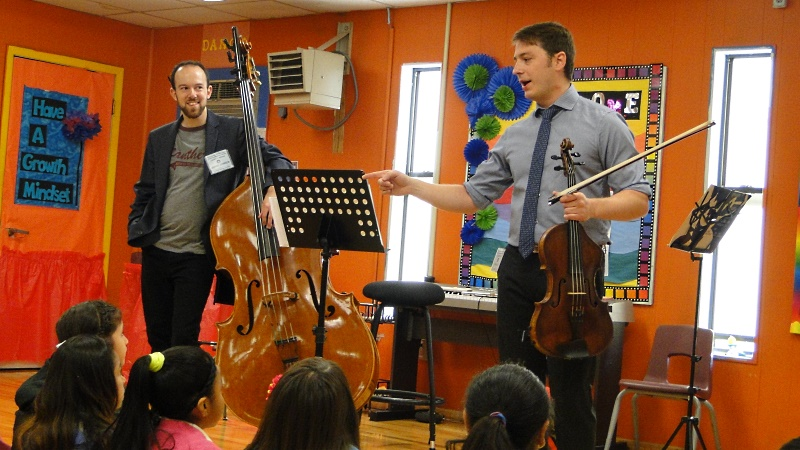 Houston Symphony Community-Embedded Musicians David Connor (bass) and Anthony Parce (viola) teach students at Crespo Elementary