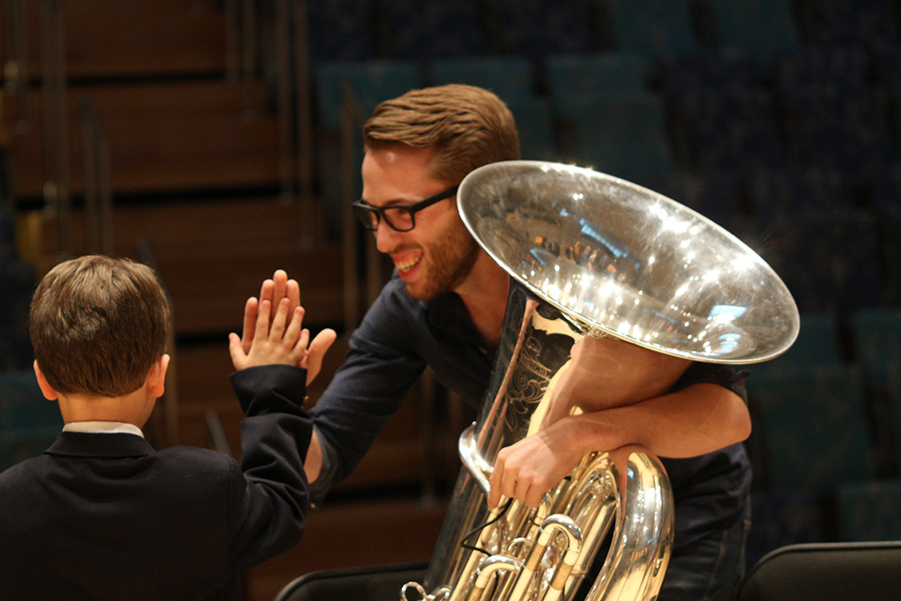 Dylan high-fives Tuba Fellow Jarrett McCourt